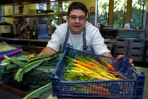 Former head chef Rupert Rowley with a range of fresh produce from the gardens at Fischer's