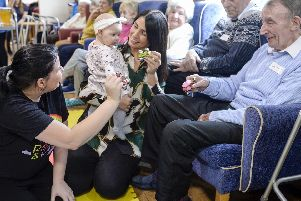 Darnall view care Home and toddler group music and sing a long session'Anne Connely, Jaime and Skyla with Dennis