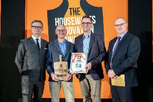 Hargreaves' Martin Coles-Evans and Kelly Coles-Evans receive the award from author and comedian Ian Moore.
