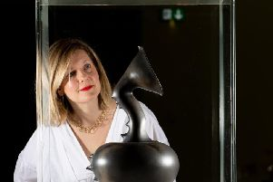 Olivia Colling from The Hepworth Wakefield with one of the objects from the new exhibition.