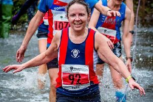 Lorraine Naylor at the river crossing in the West Yorkshire League. Photo: Stephen Smith