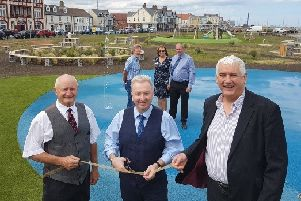 Peter Stephenson, Executive Chairman of Able UK which contributed �100,000 to the project, with Councillor Christopher Akers-Belcher and Councillor Kevin Cranney perform the ribbon-cutting ceremony.