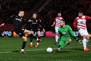 Doncaster's Marko Marosi races out to stop Barnsley's Jordan Williams