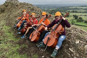 Sheffield Junior Extreme Cellists playing on top of Thorpe Cloud, Dovedale