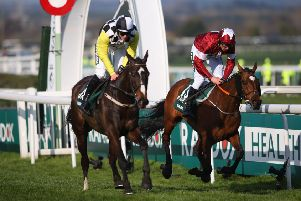 Tiger Roll (right) just holds off Pleasant Company to win last year's Grand National. Both are back for more on Saturday. (PHOTO BY: Alex Livesey/Getty Images).