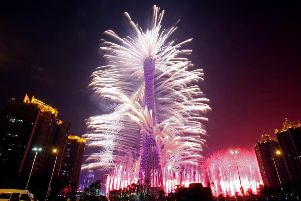 A firework display lights up the Canton tower during the opening ceremony of the 16th Asian Games in Guangzhou on November 12, 2010. Athletes from 45 countries and territories will compete in 42 sporting disciplines until November 27 as  the Asian Games officially opened with a glitzy gala ceremony, culminating years of planning for a massive event that is set to reinforce China's regional sporting dominance.  CHINA OUT   AFP PHOTO (Photo credit should read AFP/AFP/Getty Images)