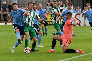 South Shields' Carl Finnigan is crowded out as Blyth Spartans get plenty behind the ball. Picture by Kev Wilson.
