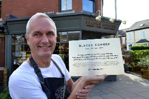 Head Chef at Blacks Corner John Craig with the brass plaque, which will be installed today.