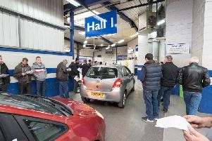 People assessing cars at Manheim