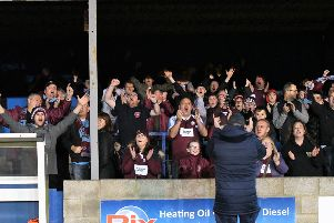 Kitman George McLaughlin celebrates with the fans after the Whitby win.