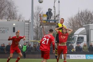 Mark Beck rises to head home Harrogate Town's third goal against Hartlepool United in front of the BT Sport cameras. Picture: Matt Kirkham