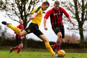 Actions from Midgley United v Denholme, at Midgley Rec. Pictured is George Bamford and Cameron Foster