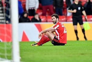 Will Grigg missed a golden chance to score on his home debut for Sunderland.