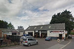 A man was attacked by another man with a knife on this garage forecourt in Rotherham yesterday