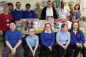 Pupils and staff from Keelman's Way School, Hebburn, handing over the gifts to at South Tyneside District Hospital