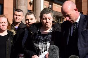 Joan Hoggett's daughter, Michelle Young, and Joan's son, Robert Young (right) are joined by other family members at Newcastle Crown Court.
