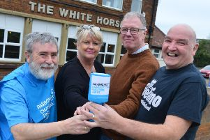 From left, John Shone from the South Shields branch of Parkinson's UK, Cath and Terry Power from The White Horse, and Graham Todd from Rivelino.