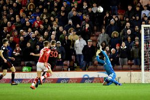 Jon McLaughlin makes an important save in the goalless draw with Barnsley.