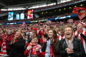 Supporters cheering on Sunderland at the Capital One Cup Final against Manchester City in 2014.