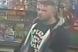 A CCTV image of a man police want to talk to in their investigation of an alleged hate crime in Wallsend.