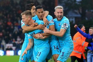 Matt Ritchie is mobbed by his team-mates.