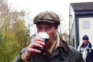 MEP Nigel Farage enjoying a pint at the end of Saturday's March to Leave at the Merry Go Round pub, Hartlepool.