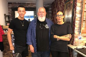 Annette and Wilson welcome Mike Holtzer, the Chief Executive Office of Upper Cut Deluxe, to their new Burnley barber shop.
