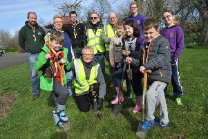 Brownsea Scout's help Friends of West Park plant trees around the park.