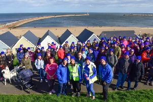The walkers get ready to leave Roker earlier on today.