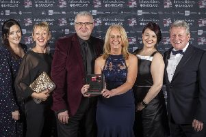 The team from Pendleside Hospice with their trophy  held by Pendleside chief executive Helen McVey, centre  which was specially-crafted by Pendle Engineering.