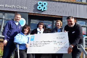 Chloe and Liam Together Forever Trust recive funds from the Co-op.'From left family's  Mark and Lisa Rutherford with Caroline Curry, store team manager Julie Gardner and area manager Michael Boucher