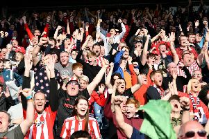 Sunderland supporters celebrate the victory.