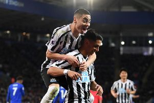 Miguel Almiron, top, celebrates with Ayoze Perez.