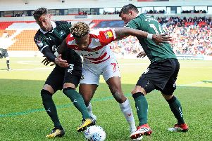 Mallik Wilks gets close attention during the win over Peterborough United