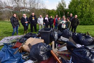 Members of th Tyne Rivers Trust and Monkton Dene Clean groups with the rubbish  rubbish collected at Monkton Burn