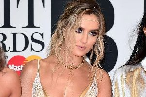 Perrie Edwards, centre