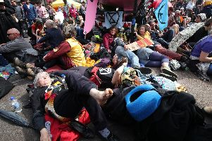 Climate activists surround a pink boat that has been parked during an Extinction Rebellion demonstration at Oxford Circus, London. Picture: Yui Mok/PA Wire.