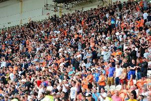 It was the Blackpool fans who were celebrating after Nathan Delfouneso's stoppage-time goal secured them the bragging rights