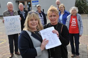 St Clare's Hospice campaigners with their petition outside Monkton Hall, Jarrow.