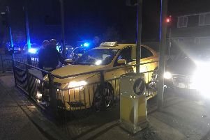 A taxi and a car smashed into a traffic light island in Hartlepool last night.