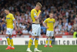Dejected Jack Clarke and shellshocked Leeds United teammates at full-time at Brentford.