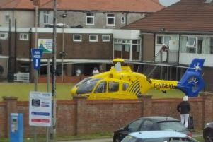 An air ambulance has landed at the bowling green at Cleveleys Working Men's Club after a person was reported injured at a nearby car park.