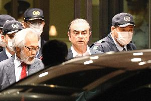 Carlos Ghosn leaves a Japanese detention centre. Picture: PA.