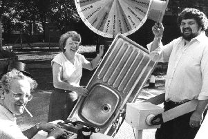 Wood Terrace Field Day in 1983. Bill Dodds on typwriter, Theresa Moor with kitchen sink and George Stanners on slimming machine.