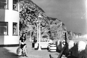 Waitress Ann Price looks over Marsden Bay from the Grotto terrace in 1972.
