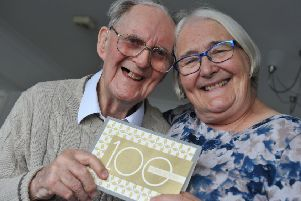 Ken Woods celebrates his 100th birthday, with daughter Susan Key.