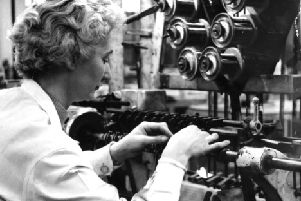 Coil winding a dozen at a time.  An operative work to wire thicknesses of 2,000th of an inch in 1963.