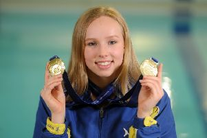 City of Leeds Swimming Club's Leah Crisp with the two gold medals she won at the British Championships last month.