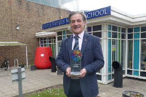 South Shields Marine School Principal John Roach with the award