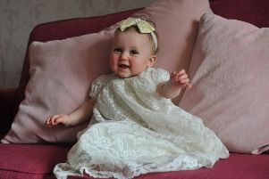Gracie Wilkinson will be getting christened in a 100 year old christening gown.
